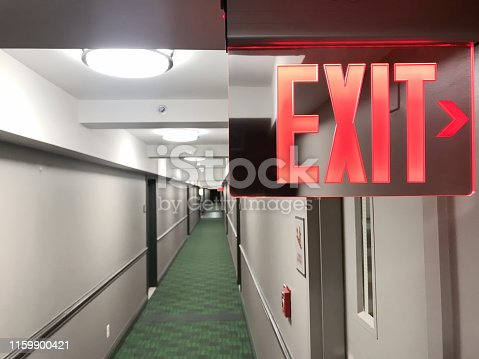 Exit sign in a corridor of a residential building