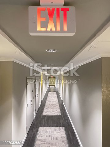 Exit sign in a corridor of a building