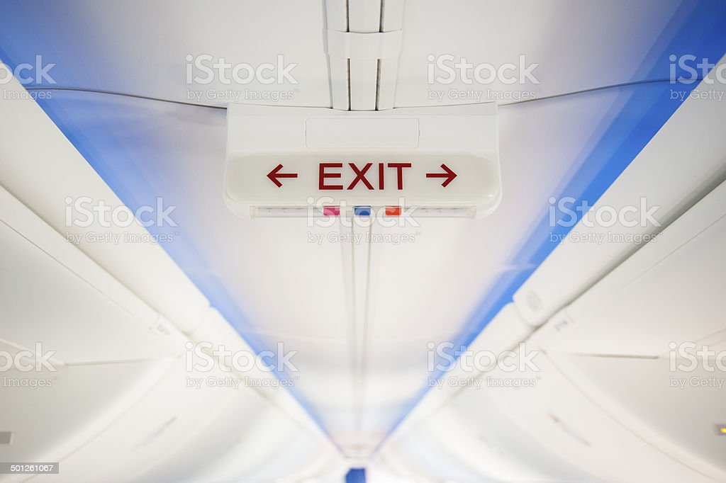 Exit sign in modern jet stock photo