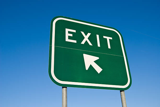 exit sign on freeway - exit sign stock photos and pictures