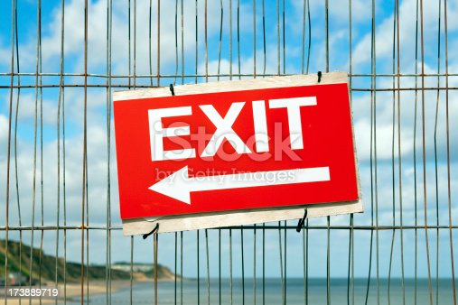 An exit sign on a safety fence on Cromer Pier, Norfolk, during repair work.