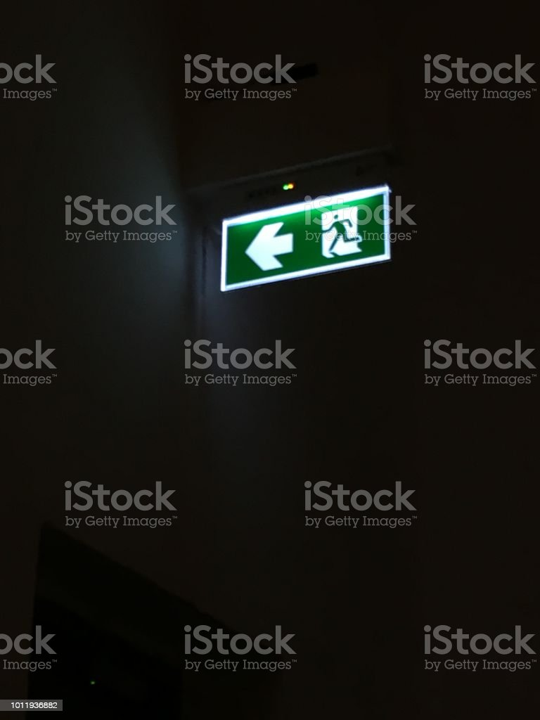 Exit Sign.Fire exit sign hanging under ceiling.