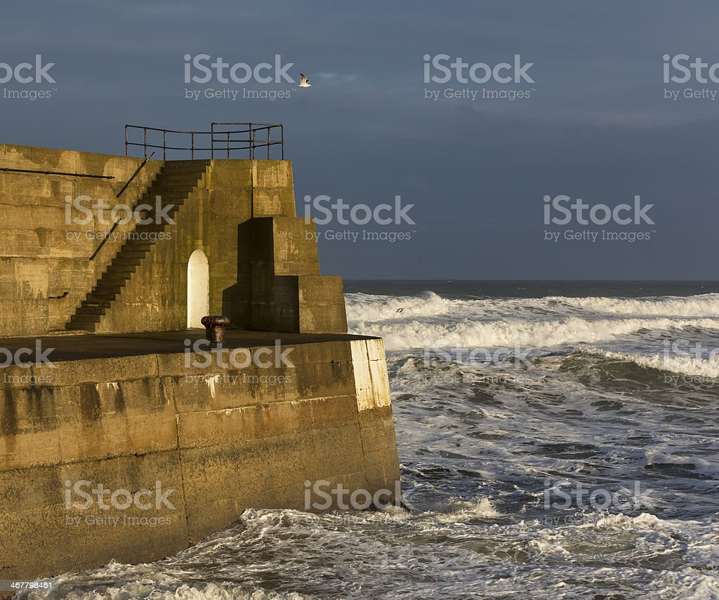 Exit to Lossiemouth Harbour in winter. stock photo