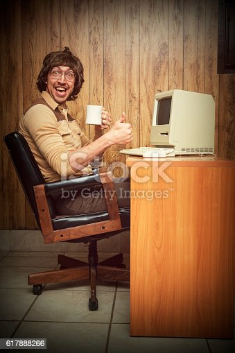 618210072 istock photo Exited Computer dorky nerd worker at desk 617888266