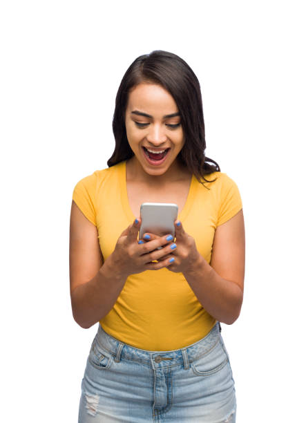 Exited young woman texting Portrait of a young woman texting with an exited facial expression. medium shot stock pictures, royalty-free photos & images