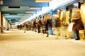 People congestion when motion blurred travellers departs subway train at platform. More Railroad pictures below