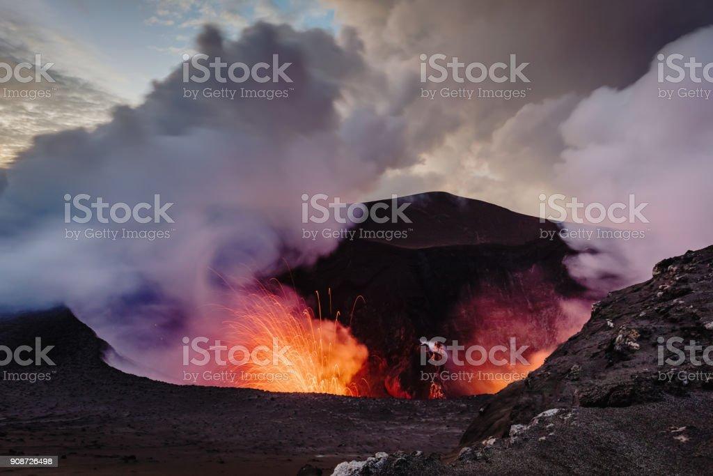 Exloding Volcano Tanna Island Erupting Mount Yasur Vanuatu Erupting Volcano Mt. Yasur, view from the crater ash top towards the erupting craterlake of the active Mount Yasur Volcano, Tanna Island, Vanuatu, Melanesia, South Pacific Active Volcano Stock Photo