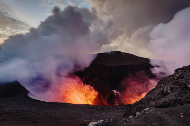 Exloding Volcano Tanna Island Erupting Mount Yasur Vanuatu Erupting Volcano Mt. Yasur, view from the crater ash top towards the erupting craterlake of the active Mount Yasur Volcano, Tanna Island, Vanuatu, Melanesia, South Pacific vanuatu stock pictures, royalty-free photos & images