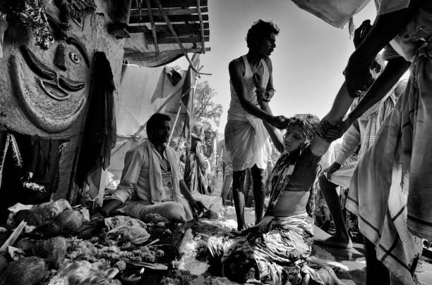 exorcism at kumbh - debiprasad mukherjee stock photos and pictures