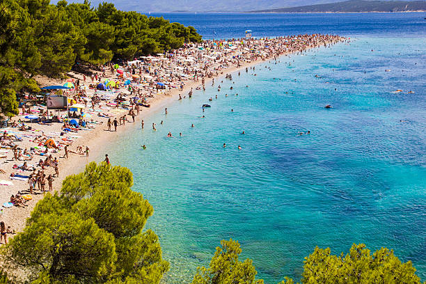 exotic beach in bol island of brac, croatia - nude beach stock-fotos und bilder