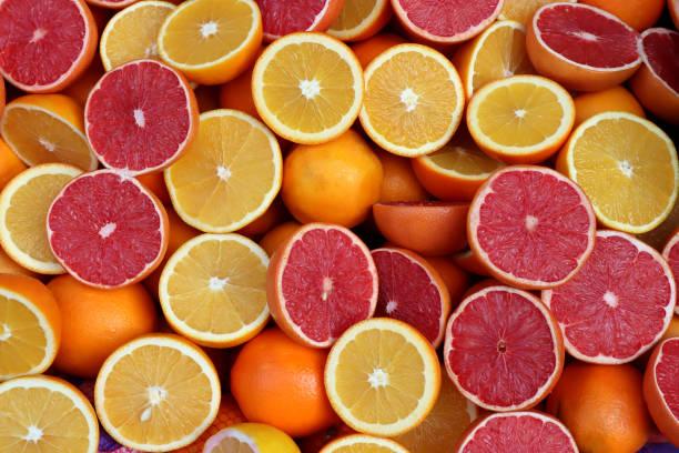 Exotic citrus slices overhead background stock photo