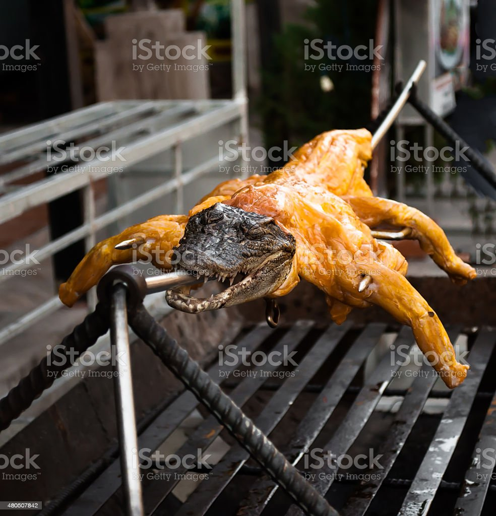 Exotic food - crocodile on grill stock photo