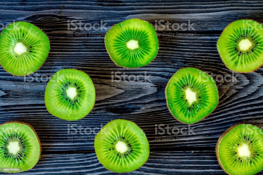 exotic fruit pattern with sliced kiwi on dark table background top view royalty-free stock photo