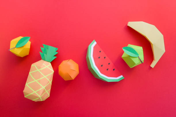 exotic fruits made of paper on red background stock photo