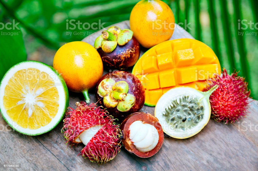 Exotic fruits on the wooden table royalty-free stock photo