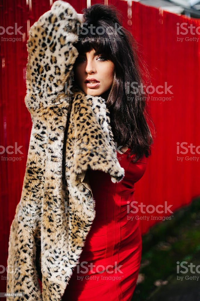 Exotic Model in Red Skirt, Vintage Leopard Print Fur Coat royalty-free stock photo