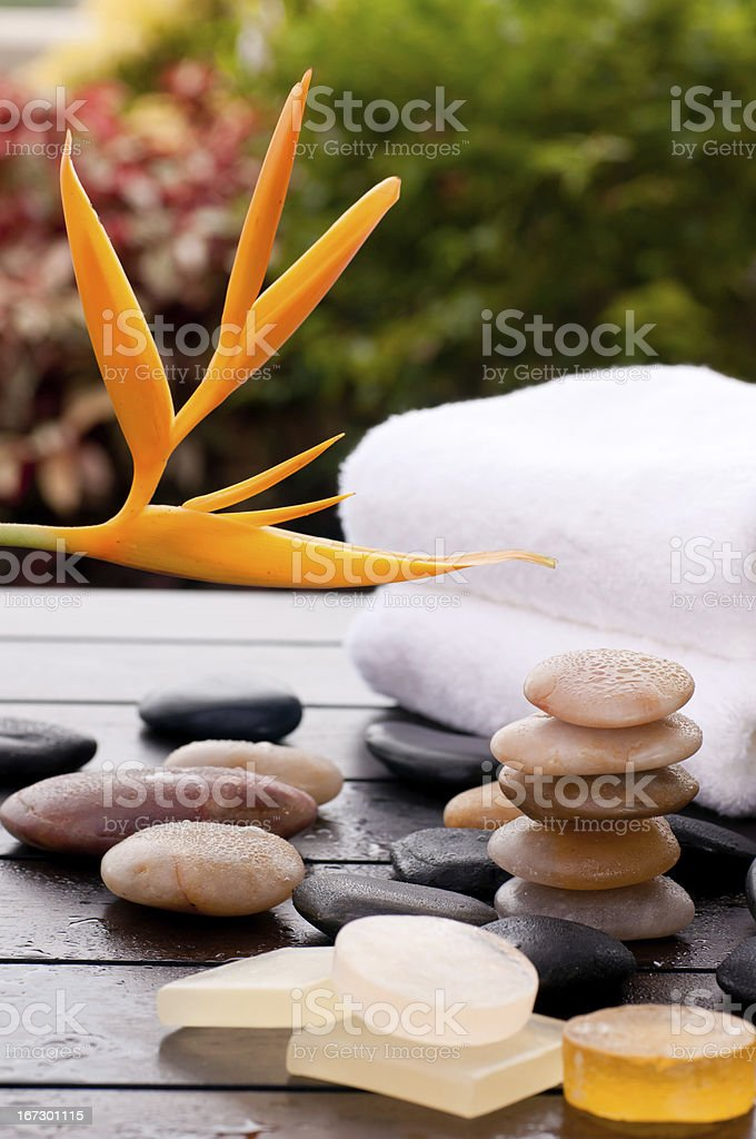Exotic spa getaway concept with zen stones and heliconia flower royalty-free stock photo