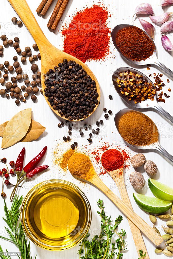 Exotic spices and herbs on white table stock photo