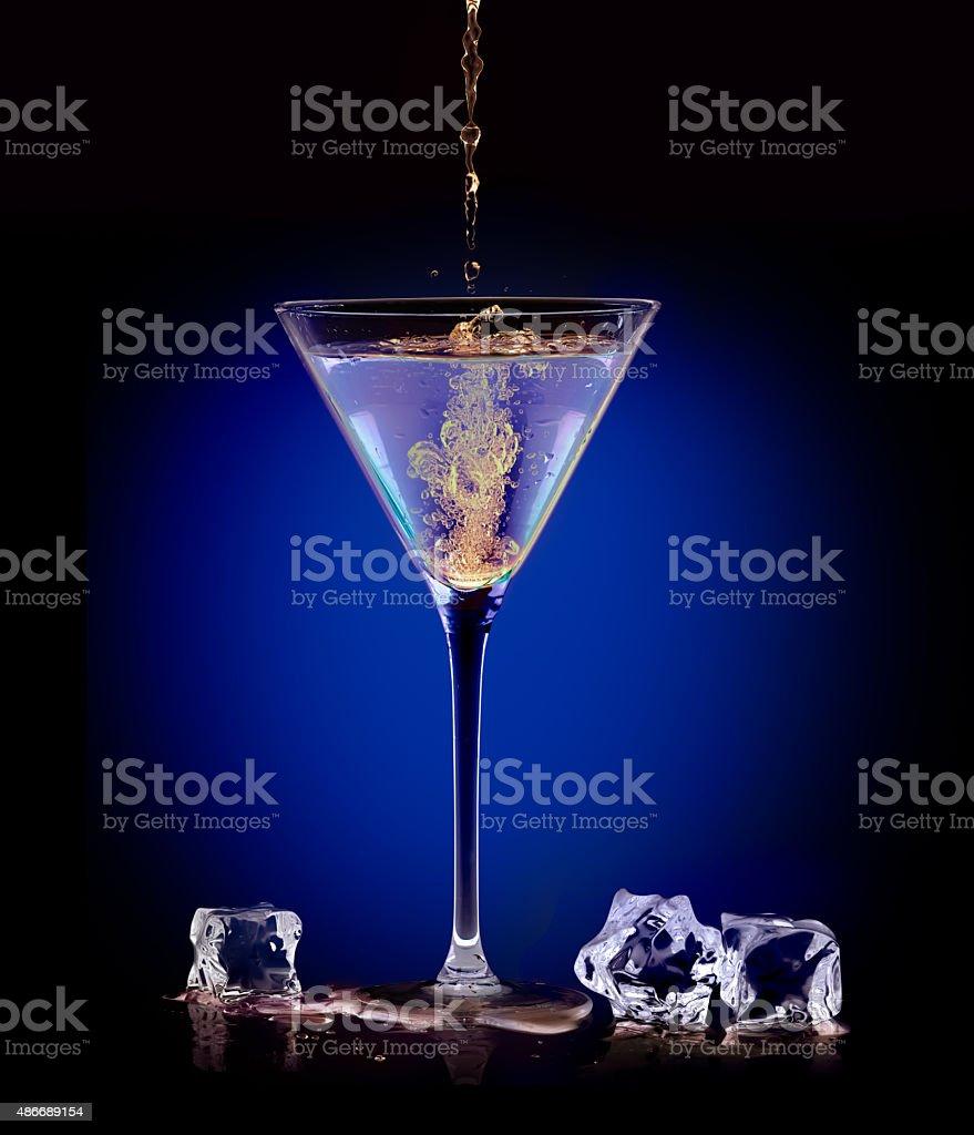 Exotic Spirit Drink. Pouring a mixer into a martini stock photo