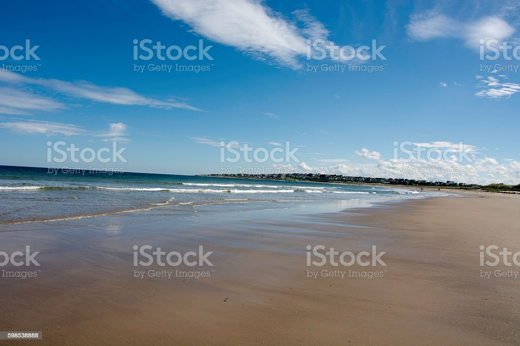 Expansive beach with Lossiemouth in the distance stock photo