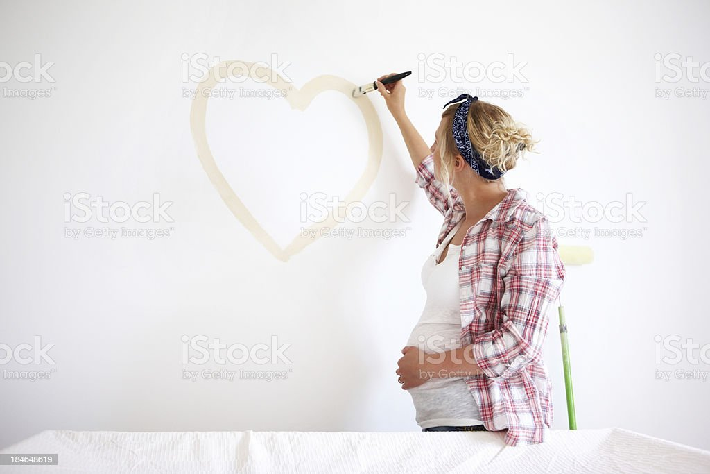 Expectant Mother Painting a Heart stock photo