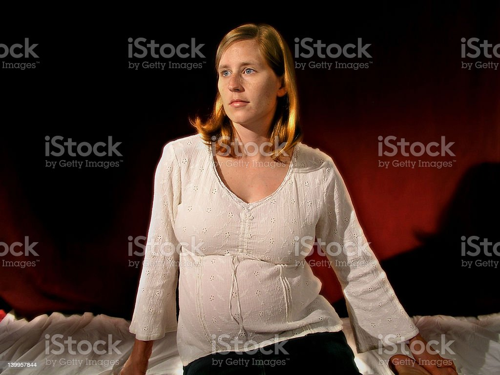Expectant mother - Red BG royalty-free stock photo