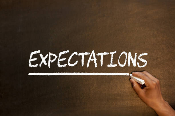 Expectations Word On Blackboard Expectations handwriting with chalk on blackboard. Business concept. anticipation stock pictures, royalty-free photos & images