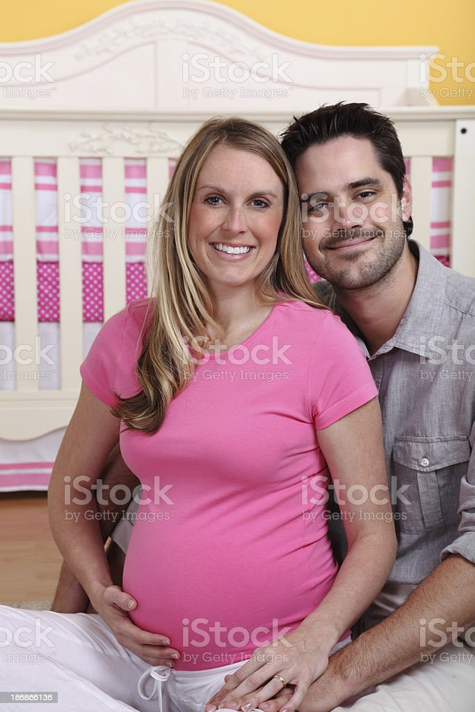 Expecting Couple In Nursery royalty-free stock photo