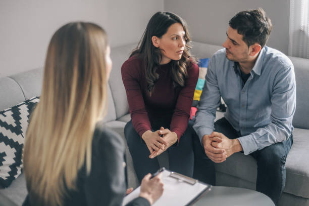Expecting couple on home counselling meeting stock photo