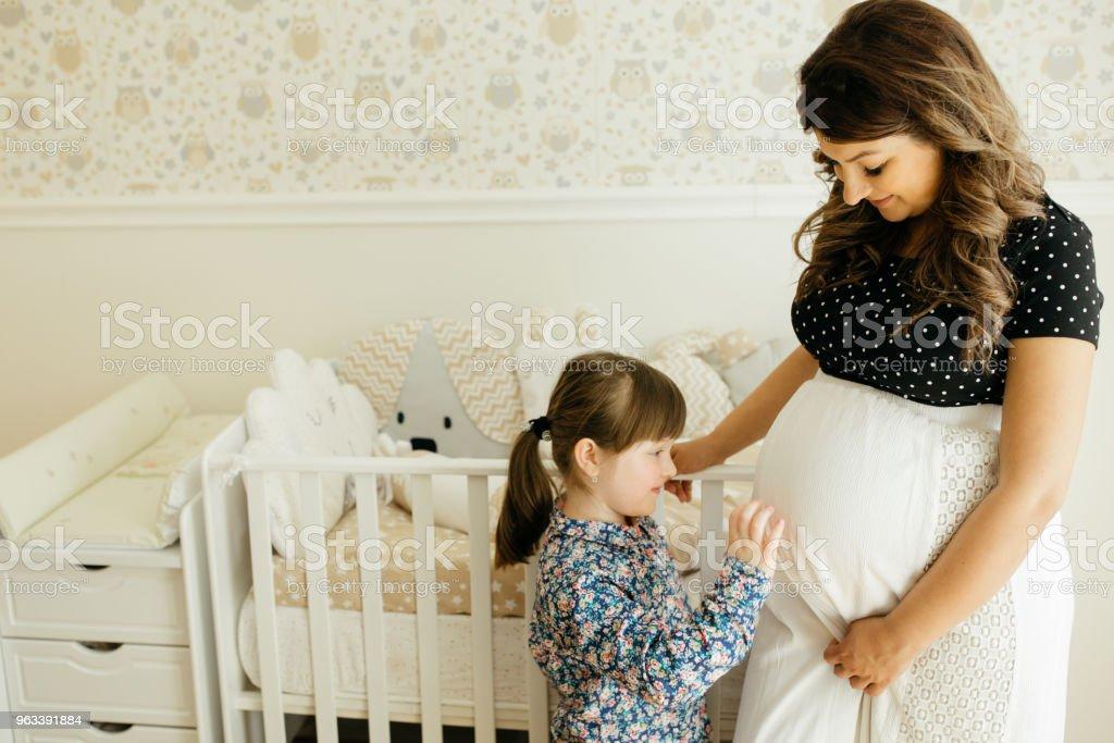 Expecting new family memeber - Zbiór zdjęć royalty-free (20-29 lat)