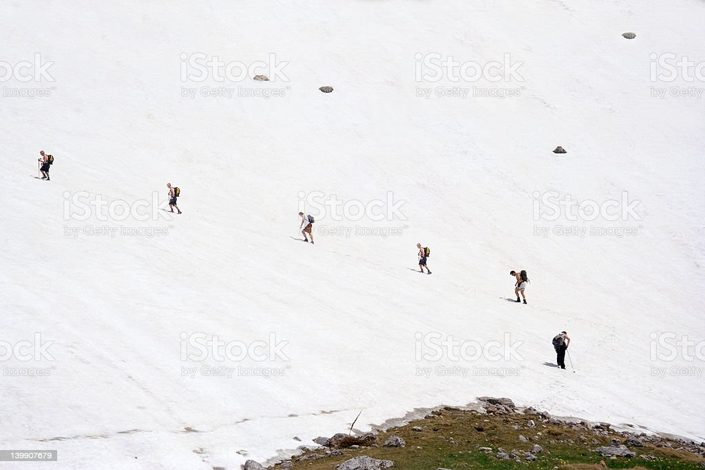 Expedition climbing a mountain peak royalty-free stock photo