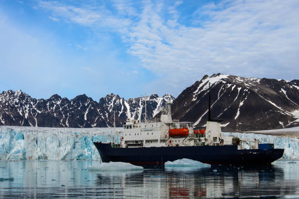 Expedition vessel in Arctic sea stock photo
