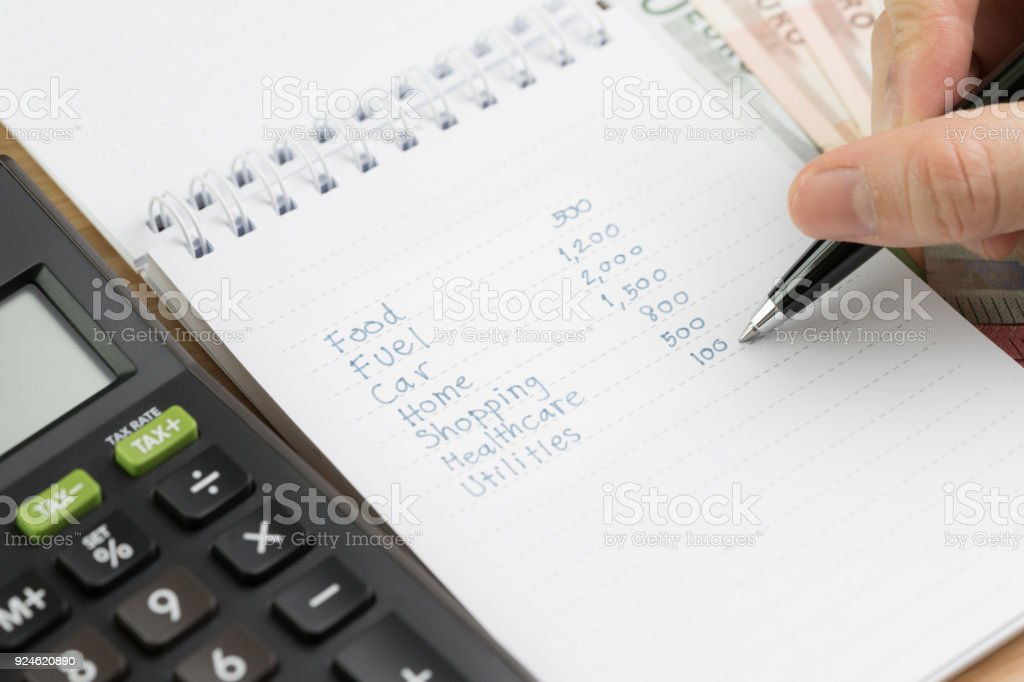 expense calculation or money spent pay day concept hand holding pen