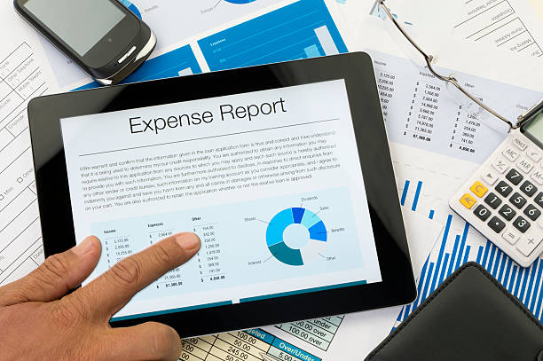 Expense report on a digital tablet Expense report on a digital tablet with paperwork expense stock pictures, royalty-free photos & images