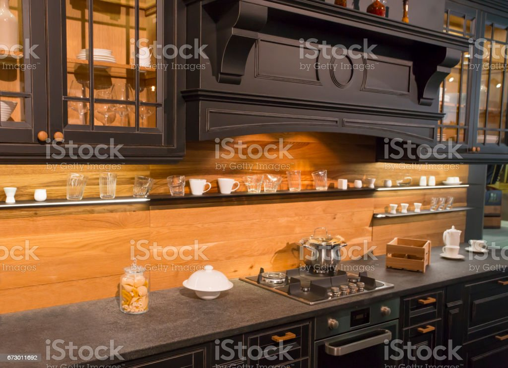 expensive colonial style black kitchen furniture stock photo