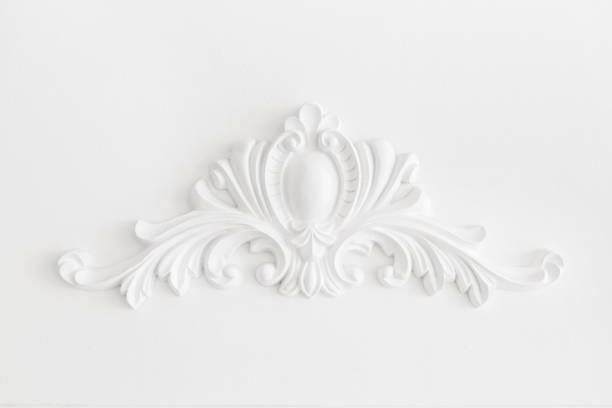 Expensive interior. Stucco elements on light luxury wall. White patterned. Mouldings element from gypsum. Roccoco style stock photo