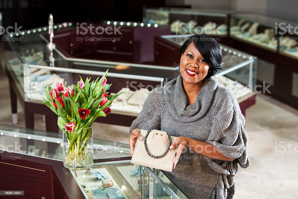 Expensive necklace and earring set on display stock photo