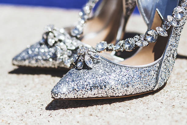 expensive shoes with jewelry shine in the sun - gold glitter schuhe stock-fotos und bilder