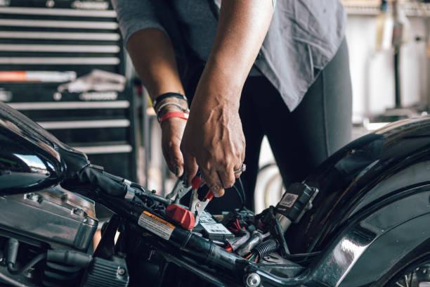 experience woman bike builder stock photo