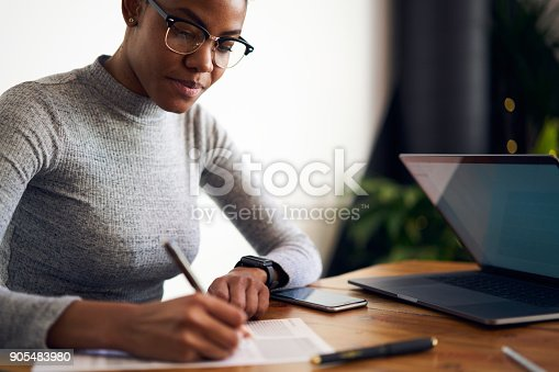 istock Experienced afro american female owner of business signing contract with corporation for making rebranding campaign to attract customers choosing best professional experts in online database 905483980
