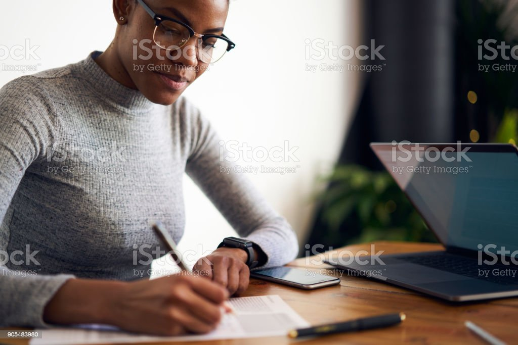 Experienced afro american female owner of business signing contract with corporation for making rebranding campaign to attract customers choosing best professional experts in online database stock photo