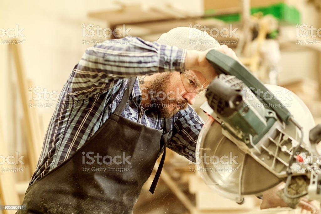 Experienced  carpenter  work in workshop zbiór zdjęć royalty-free