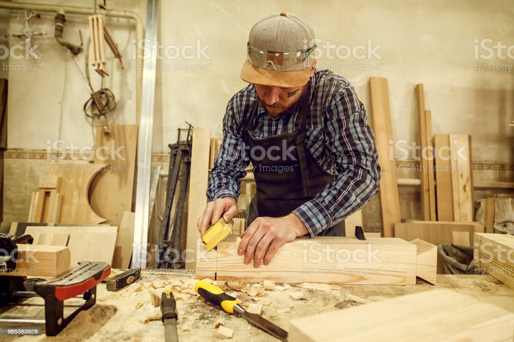 Experienced  carpenter  work in workshop royalty-free stock photo