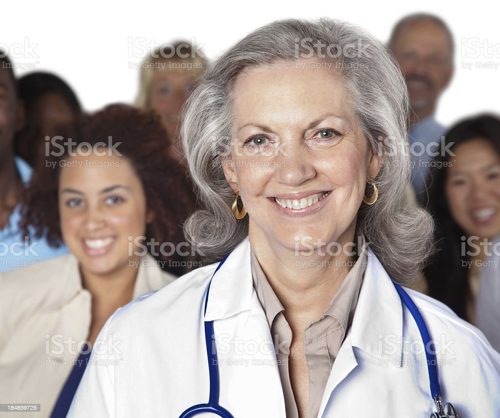 Experienced doctor in front of her patients royalty-free stock photo