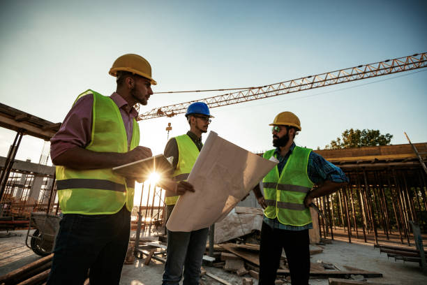 Experienced engineer explaining the problems in construction works stock photo