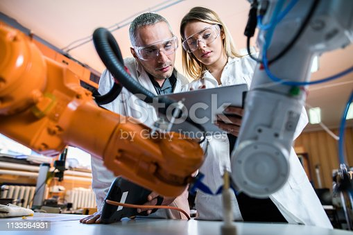 Two lab workers working together in laboratory,