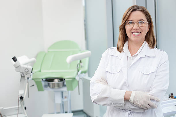 Experienced female general practitioner waiting for patient stock photo