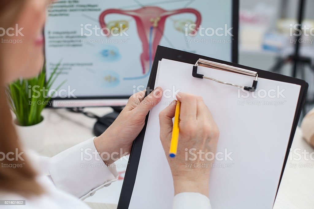 Experienced general practitioner is working with documents stock photo
