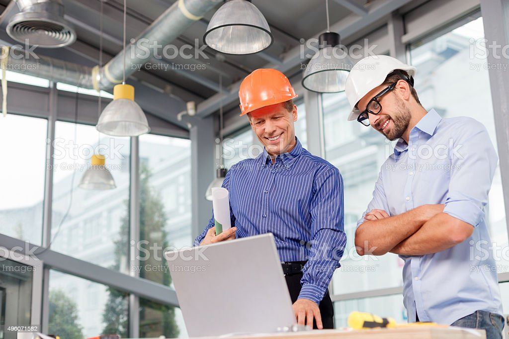 Experienced male architects are working with a notebook stock photo