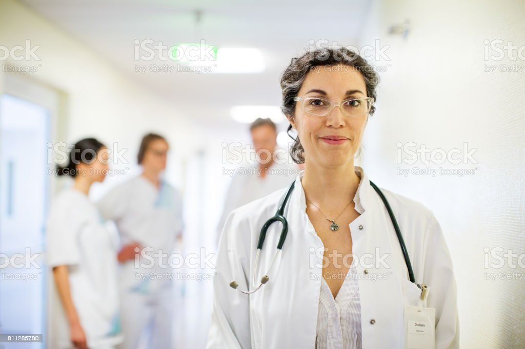 Experienced mature female doctor in hospital stock photo